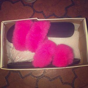 Hot pink fur slides .